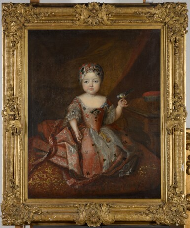 View 2. Thumbnail of Lot 194. WORKSHOP OF ANTOINE PESNE | Portrait of a girl, full-length, wearing a pink embroidered dress, holding a songbird.