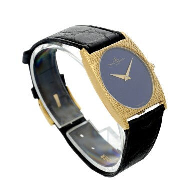 View 3. Thumbnail of Lot 1056. REFERENCE 37073 A YELLOW GOLD OVAL WRISTWATCH WITH LAPIS LAZULI DIAL, CIRCA 1980.