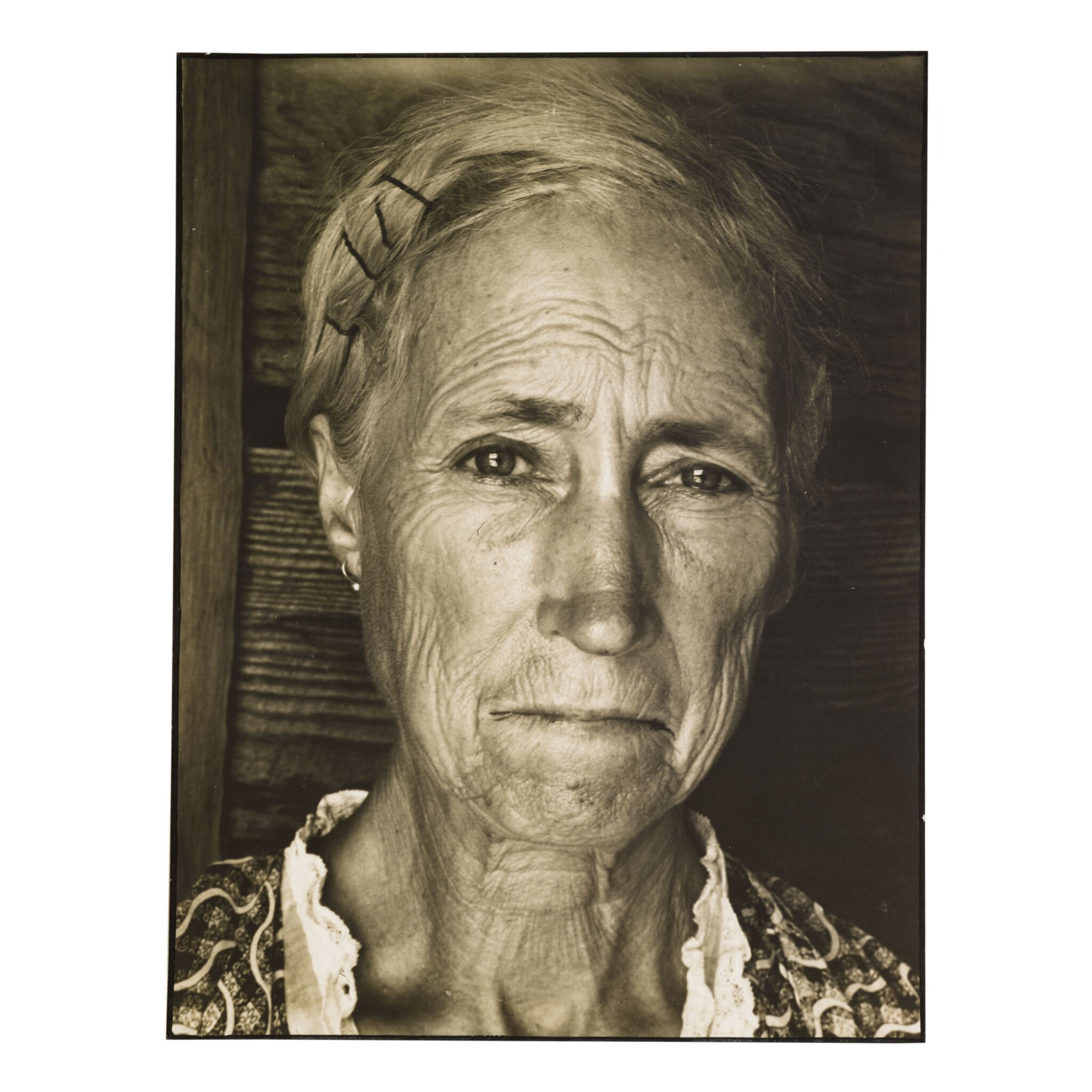 View full screen - View 1 of Lot 34.  MARGARET BOURKE-WHITE | TENANT FARMER'S WIFE (LOCKET, GEORGIA).