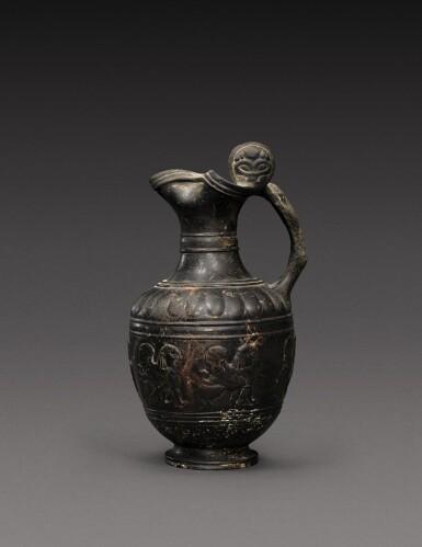 View 1. Thumbnail of Lot 53. A Bucchero Ware Pottery Oinochoe, 7th/6th Century B.C..