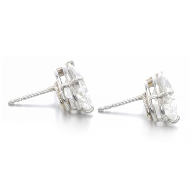 View 2. Thumbnail of Lot 1019. Pair of diamond ear studs.