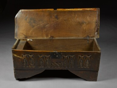 View 5. Thumbnail of Lot 5. A rare English oak boarded and relief carved chest, late 15th / early 16th century.
