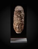 An important fragmentary relief head of an attendant Sui dynasty-Tang dynasty, ca. 7th century   隋至唐 約七世紀 石浮雕神首殘件