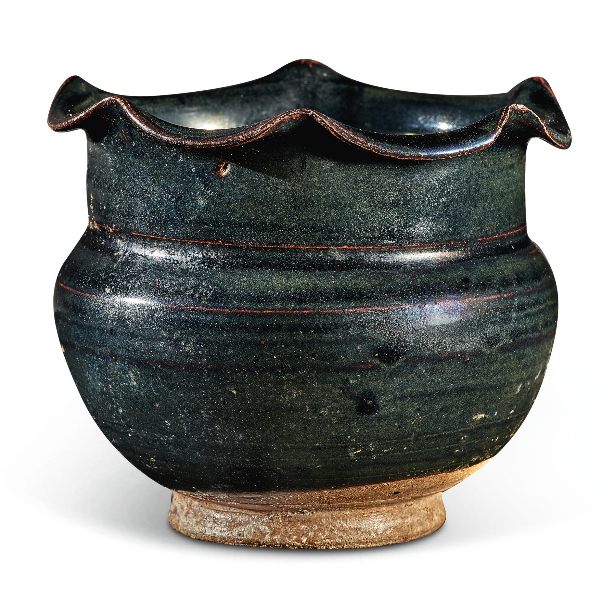 View full screen - View 1 of Lot 104. A rare black-glazed foliate-rimmed jar, Northern Song / Jin dynasty   北宋 / 金 黑釉花口罐.