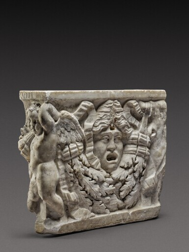 View 1. Thumbnail of Lot 80. A Roman Marble Garland Sarcophagus Fragment, circa A.D. 135.