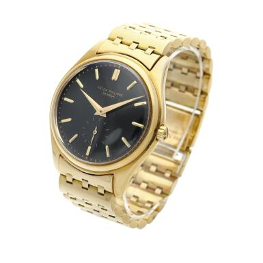 View 2. Thumbnail of Lot 227. Reference 2526  A yellow gold wristwatch with a first series black enamel dial and bracelet, Made in 1954 .