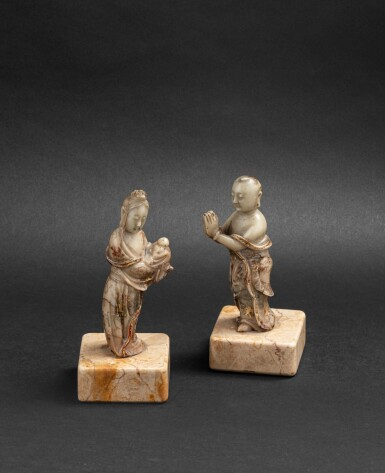 View 1. Thumbnail of Lot 159. Deux petites figures d'adorants bouddhistes en stéatite Dynastie Qing, XVIIE-XVIIIE siècles | 清十七至十八世紀 壽山石雕人物立像兩尊 | Two finely carved and incised-gilt soapstone Buddhist acolytes, Qing Dynasty, 17th-18th century.