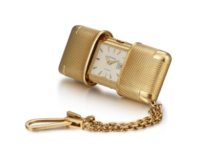CARTIER | A YELLOW GOLD TRAVEL WATCH WITH DATE, CIRCA 1950