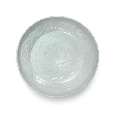View 1. Thumbnail of Lot 91. A molded 'Shufu' white-glazed 'lotus' dish, Yuan dynasty | 元 樞府白釉印花纏枝蓮紋盤.