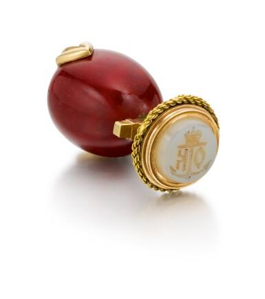 View 1. Thumbnail of Lot 233. A Fabergé gold, purpurine and agate desk seal, workmaster Erik Kollin, St Petersburg, 1899-1901.