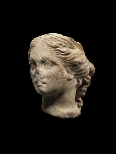 View 1. Thumbnail of Lot 40. A Roman Marble Head of Aphrodite or a Muse, circa 1st Century A.D..