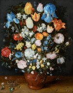 A lavish still life of many flowers in a terracotta vase resting on a wooden ledge, flanked by a clump of cyclamen and scattered diamonds and sapphires   《靜物:木檯上赤陶瓶中的絢爛花卉,伴一簇仙客來、幾顆鑽石及藍寶石》