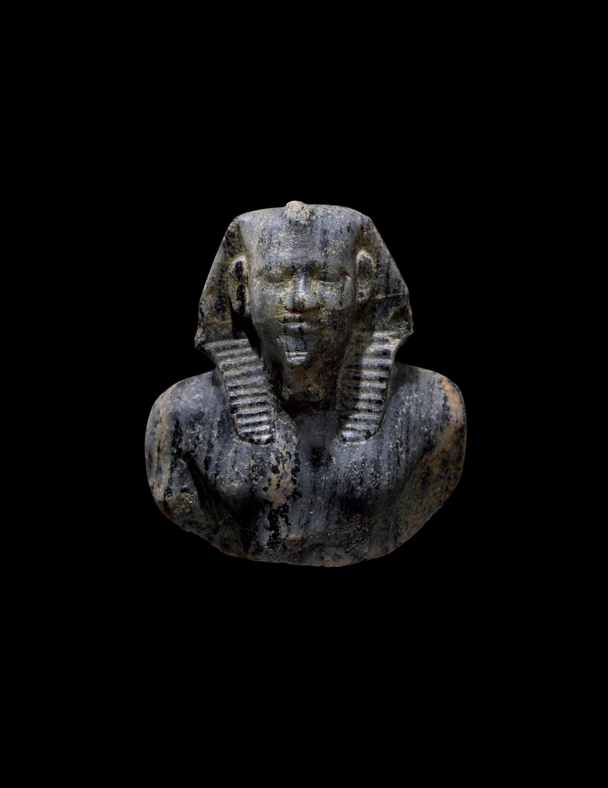 "View full screen - View 1 of Lot 266. AN EGYPTIAN GNEISS (""CHEPHREN DIORITE"") BUST OF MYCERINUS, 4TH DYNASTY, REIGN OF MYCERINUS, CIRCA 2550-2530 B.C.."