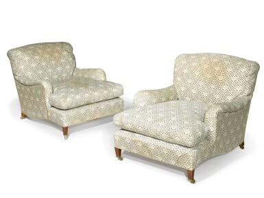 View 1. Thumbnail of Lot 104. A pair of Edwardian mahogany 'Ivor' easy armchairs by Howard & Sons, circa 1910.