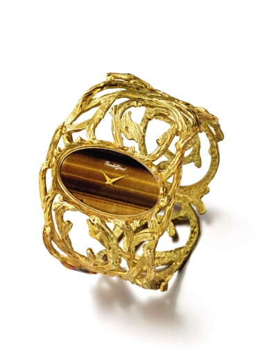 View 2. Thumbnail of Lot 48. BUECHE GIROD | AN UNUSUAL YELLOW GOLD CUFF WATCH WITH TIGER'S EYE DIAL CIRCA 1975.