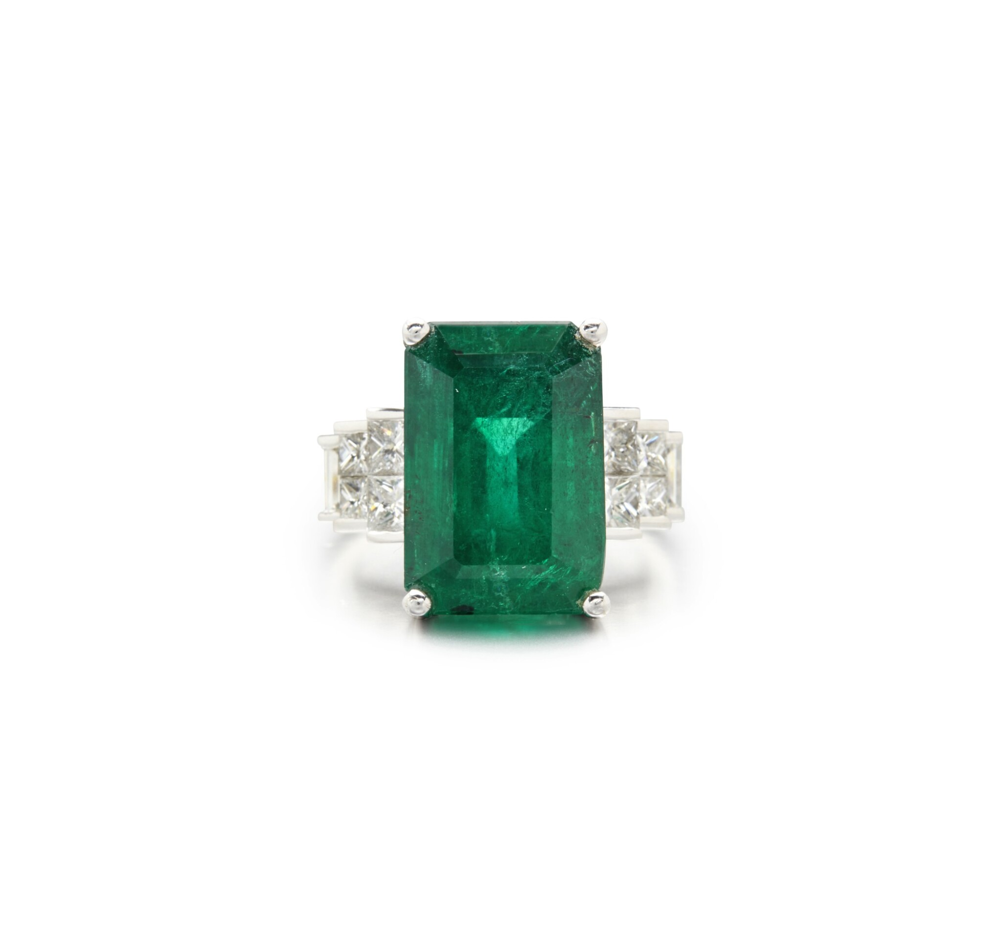 View full screen - View 1 of Lot 64. EMERALD AND DIAMOND RING.