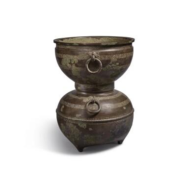 View 4. Thumbnail of Lot 20. An archaic bronze ritual food steamer (Yan), Eastern Zhou dynasty, early Warring States period   東周 戰國初 青銅交龍紋鋪首耳甗.