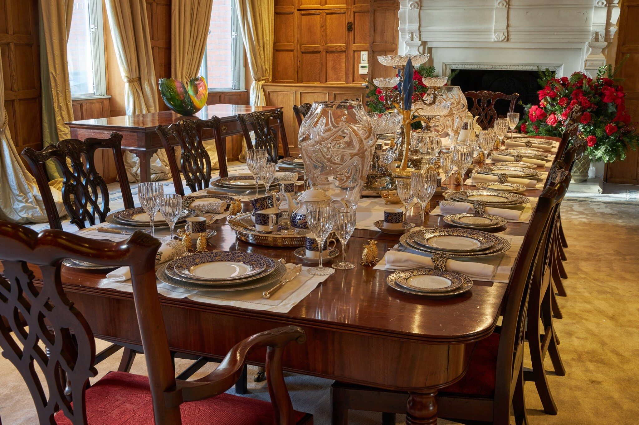 View full screen - View 1 of Lot 44. An early 19th C Mahogany Dining Table by Gillow & Co. with a set of 12 carved Dining Chairs in the Chippendale Style, and a Thomas Goode 'Stewart' bone china part dinner and dessert service, and an original antique glass from the Thomas Goode archive, various dates.