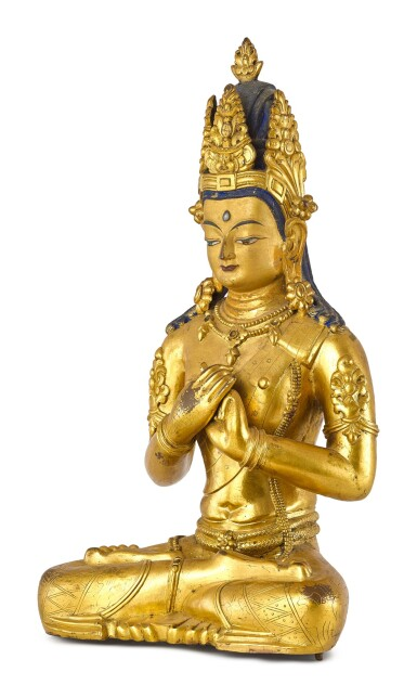 A LARGE GILT-BRONZE FIGURE OF VAIROCANA, TIBET, THE FIGURE CIRCA 1900, THE STAND CIRCA 1400 | 約1900年 藏傳鎏金銅毗盧遮那佛坐像 配 約1400年 鎏金銅蓮座