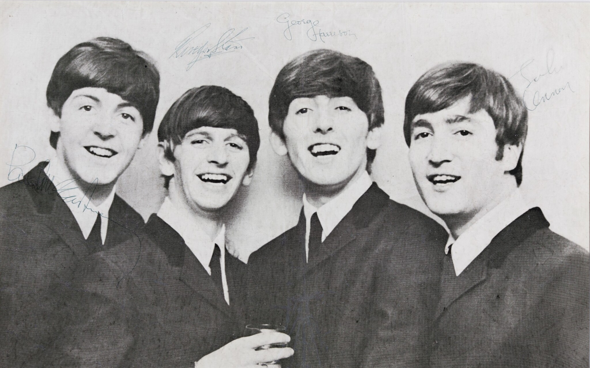 View 1 of Lot 2. THE BEATLES | photograph signed by all four Beatles, 1964.