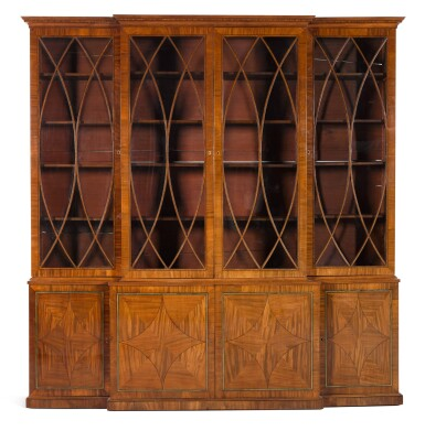 View 4. Thumbnail of Lot 59. A Regency brass inlaid and ebony strung mahogany breakfront library bookcase, circa 1815.