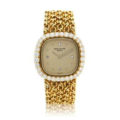 View 1. Thumbnail of Lot 99. Reference 4524/1  A yellow gold and diamond-set cushion shaped wristwatch, Circa 1982.