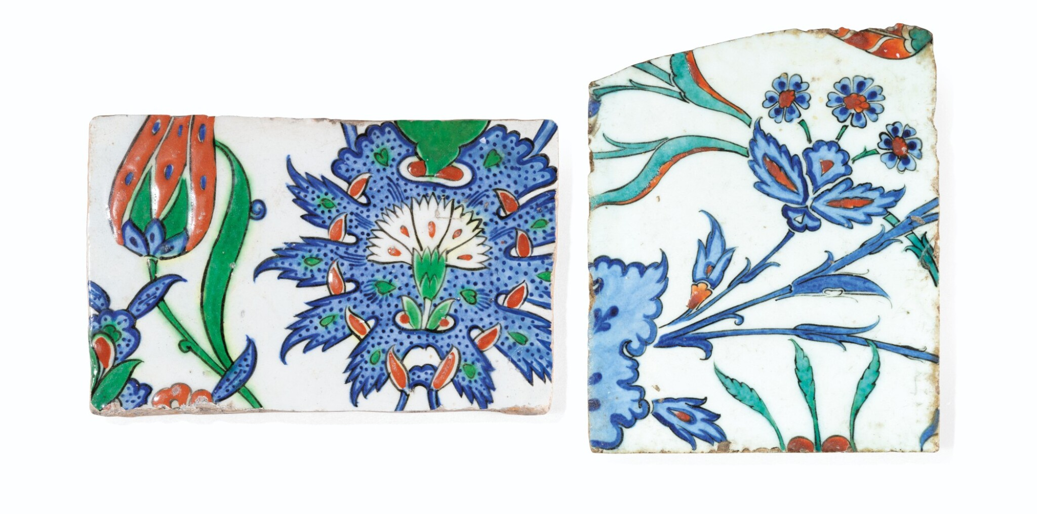 View full screen - View 1 of Lot 128. Two Iznik Pottery Tile Fragments, Ottoman Turkey, Late 16th Century.
