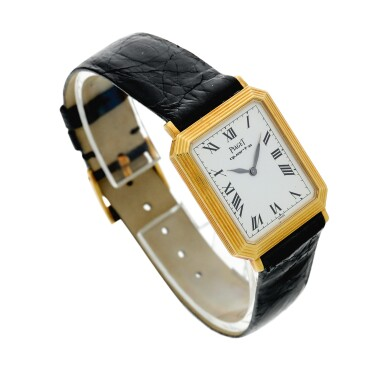 View 3. Thumbnail of Lot 138. Reference 7142 A yellow gold rectangular shaped wristwatch with ridged bezel, Circa 1975.