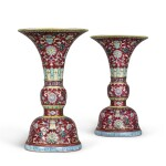 A PAIR OF RUBY-GROUND FAMILLE-ROSE 'BAJIXIANG' ALTAR VASES (GU),  QIANLONG SEAL MARKS AND PERIOD