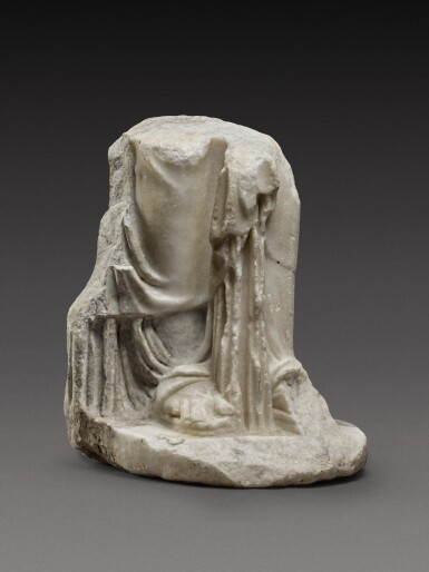 View 1 of Lot 88. A Fragmentary Roman Marble Figure of a Woman or Goddess, circa 2nd Century A.D..
