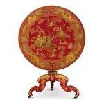 A GEORGE IV RED JAPANNED CIRCULAR TILT-TOP TRIPOD TABLE, CIRCA 1830