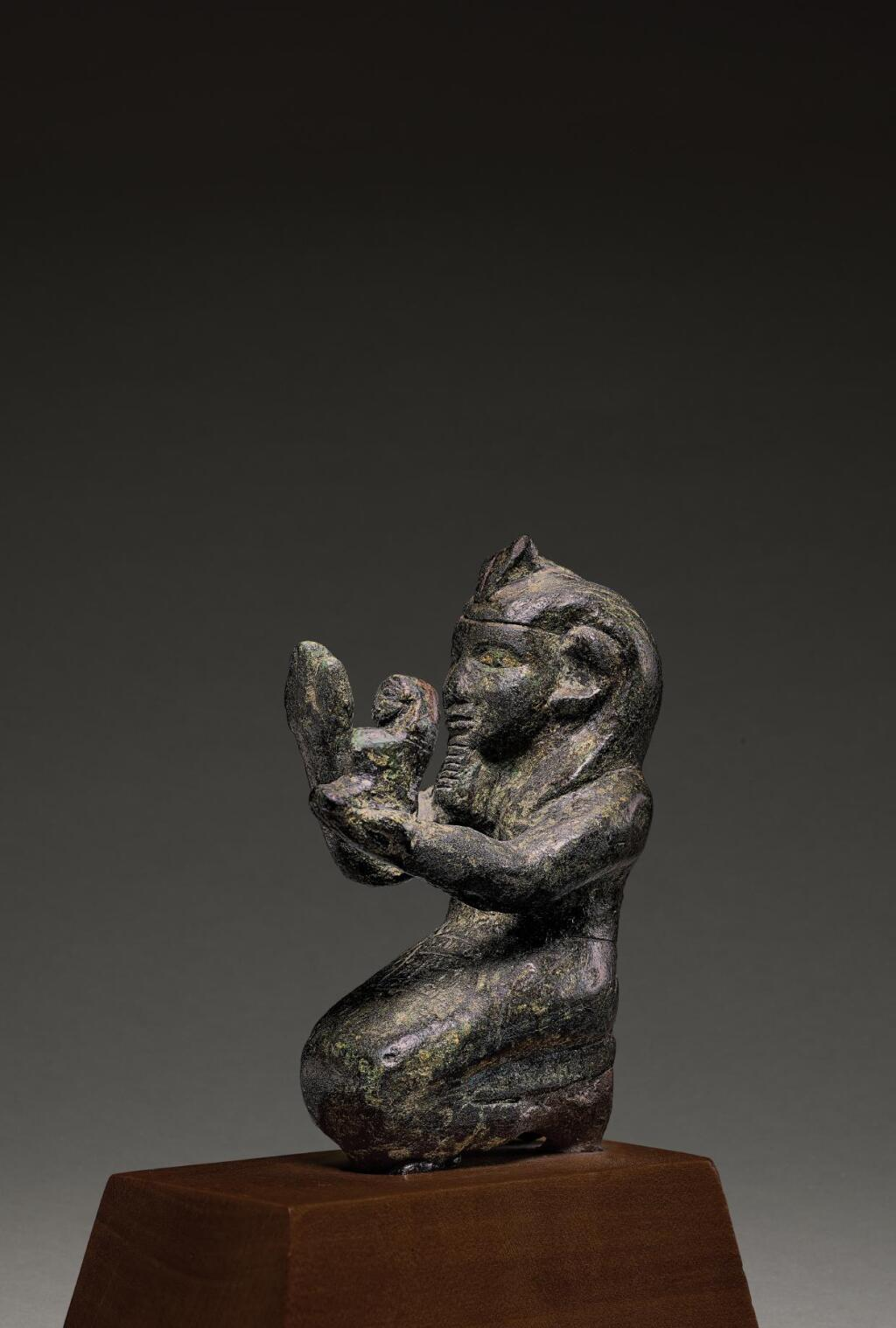 AN EGYPTIAN BRONZE FIGURE OF A KUSHITE KING, 25TH DYNASTY, 750-656 B.C.