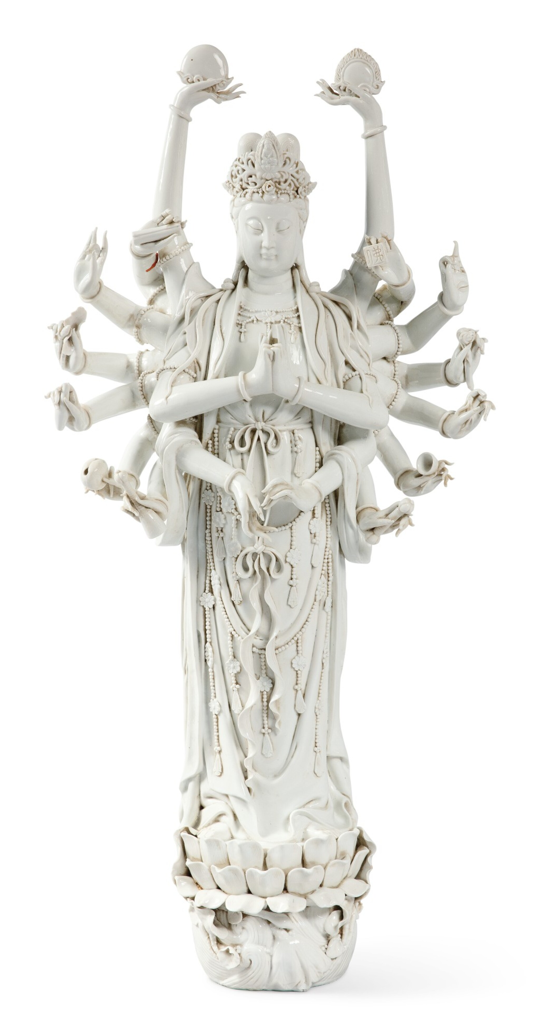 View 1 of Lot 1149.  A VERY LARGE 'DEHUA' FIGURE OF MULTI-ARM GUANYIN, 19TH / 20TH CENTURY.