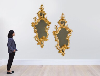 View 4. Thumbnail of Lot 44. A pair of late George II carved giltwood mirrors, circa 1755, in the manner of William and John Linnell.