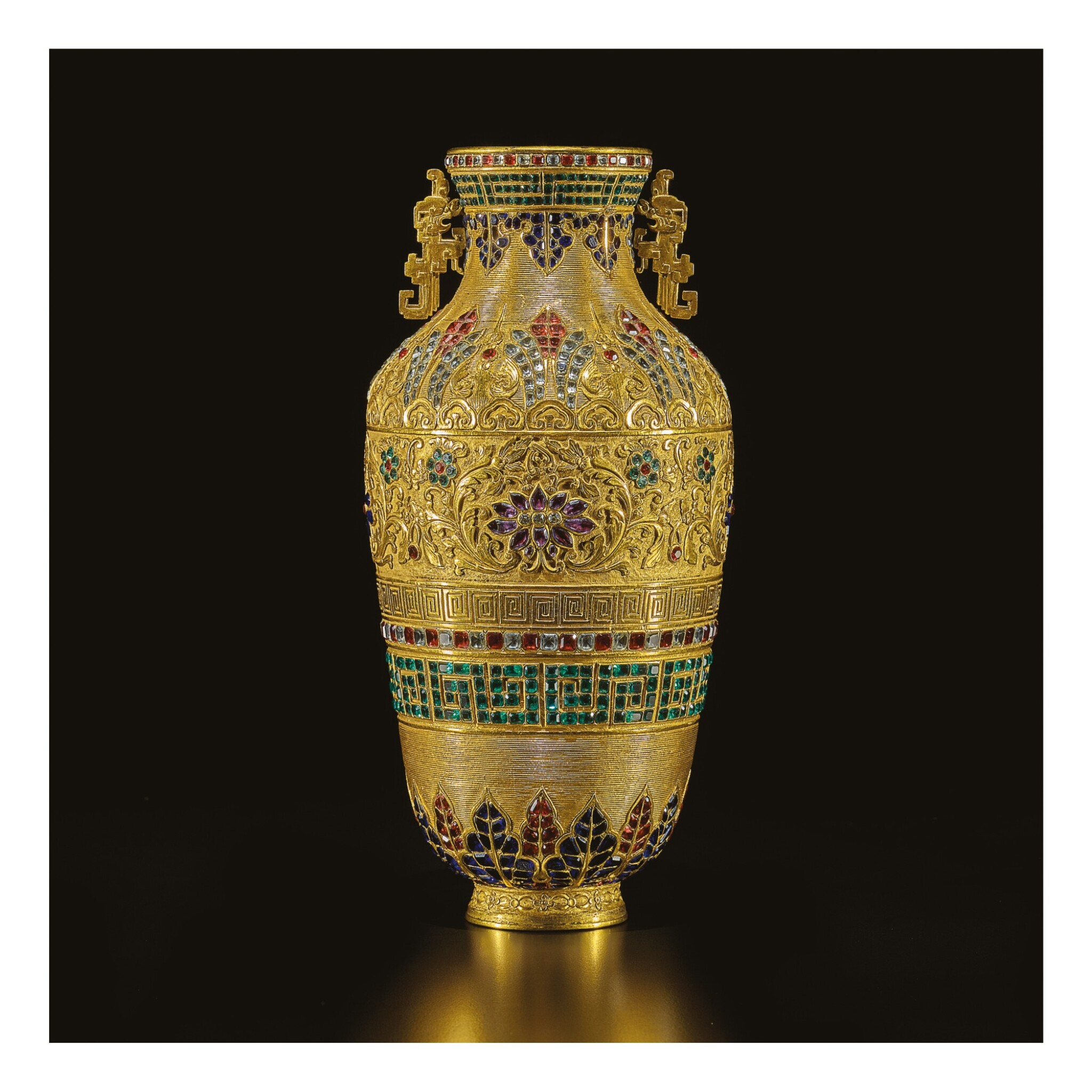View full screen - View 1 of Lot 637. A RARE PASTE-INSET GILT-BRONZE REPOUSSE VASE,  QING DYNASTY, QIANLONG PERIOD.