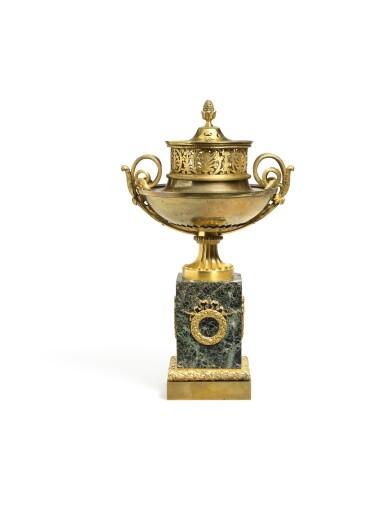 View 1. Thumbnail of Lot 188. An Empire gilt-bronze brûle-parfum, early 19th century.