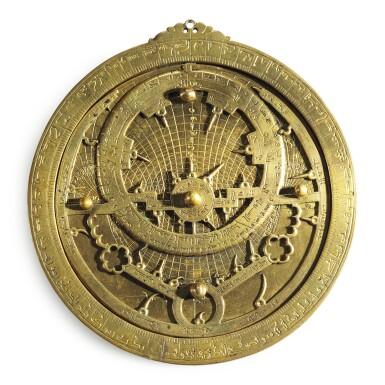 View 2. Thumbnail of Lot 66. A gilt-brass astrolabe signed by Ahmad ibn Abu 'Abdallah al-Qurtubi al-Yamani, North-East Spain, Tudela, dated 737 AH/1336-37 AD.