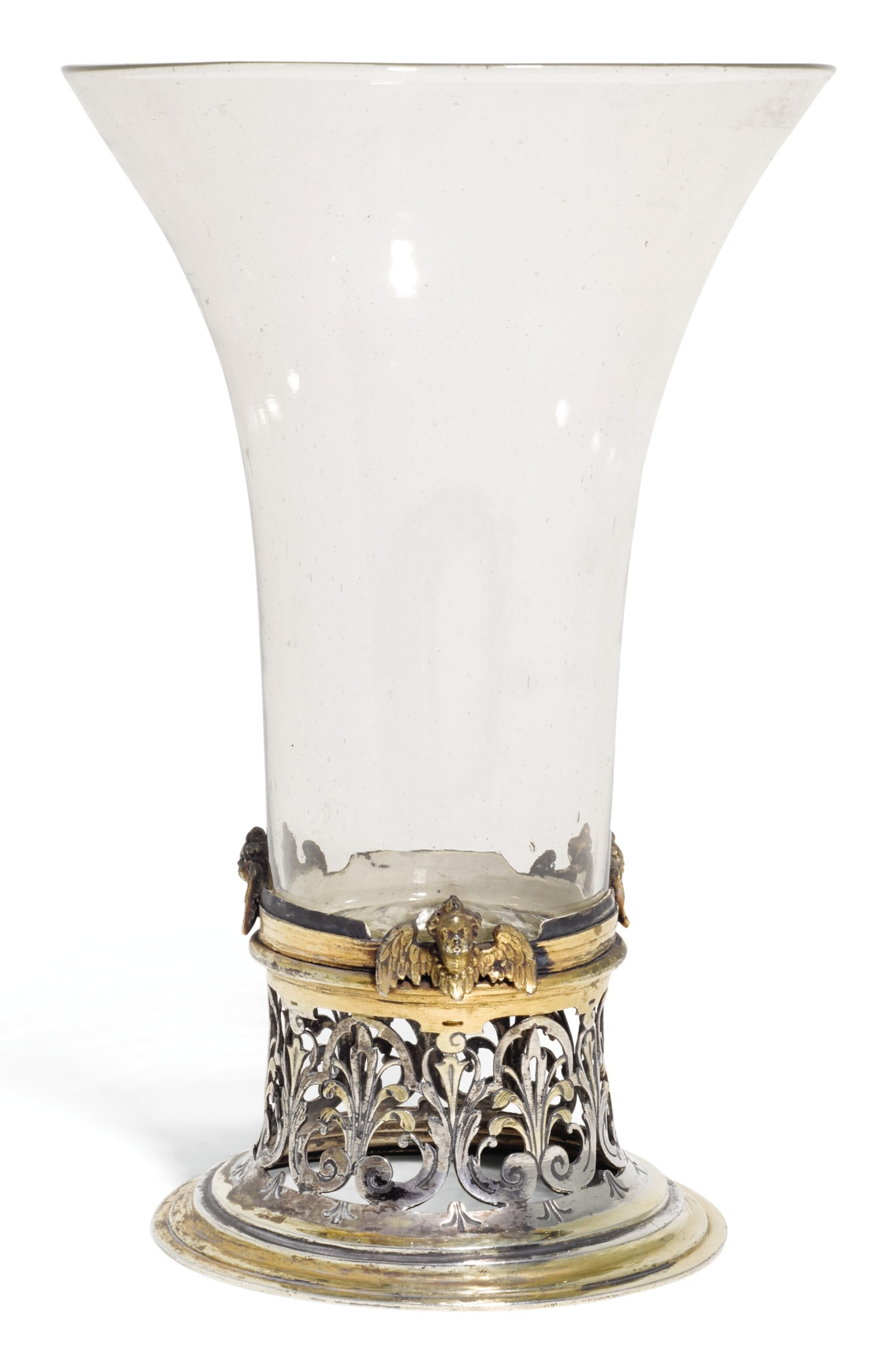 View 1 of Lot 142. AN ITALIAN GLASS BEAKER WITH CONTINENTAL PARCEL-GILT SILVER FOOT MOUNT, UNMARKED, CIRCA 1630.