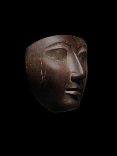 View 3. Thumbnail of Lot 58. An Egyptian Wood Mummy Mask, 22nd/24th Dynasty, 944-716 B.C..