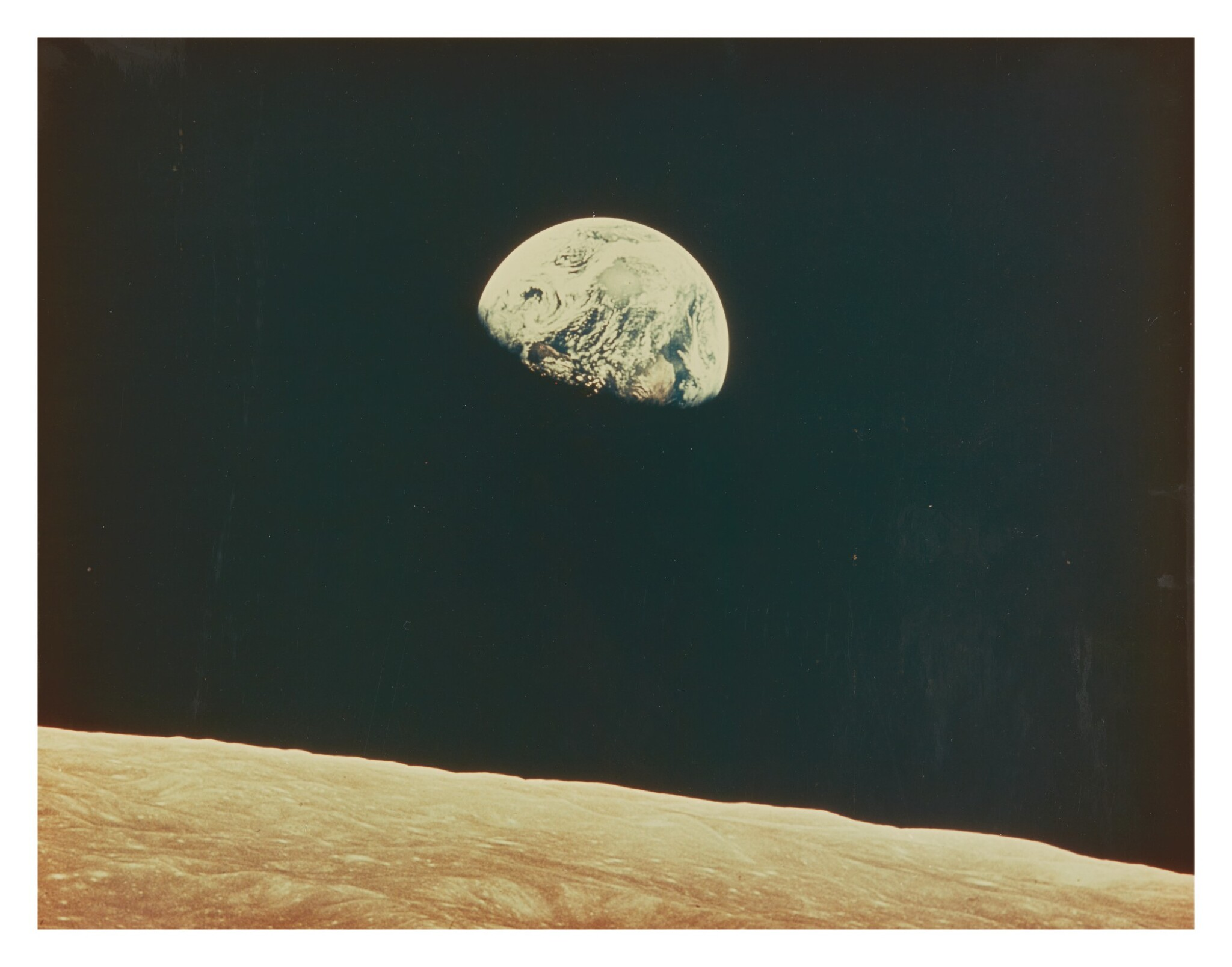 [APOLLO 8] EARTHRISE, AS PHOTOGRAPHED FROM THE APOLLO 8 CM. VINTAGE LARGE FORMAT PHOTOGRAPH, 24 DECEMBER 1968.