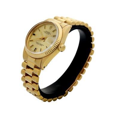 View 2. Thumbnail of Lot 81. REFERENCE 6827 DATEJUST A YELLOW GOLD AUTOMATIC WRISTWATCH WITH DATE AND BRACELET, CIRCA 1979.