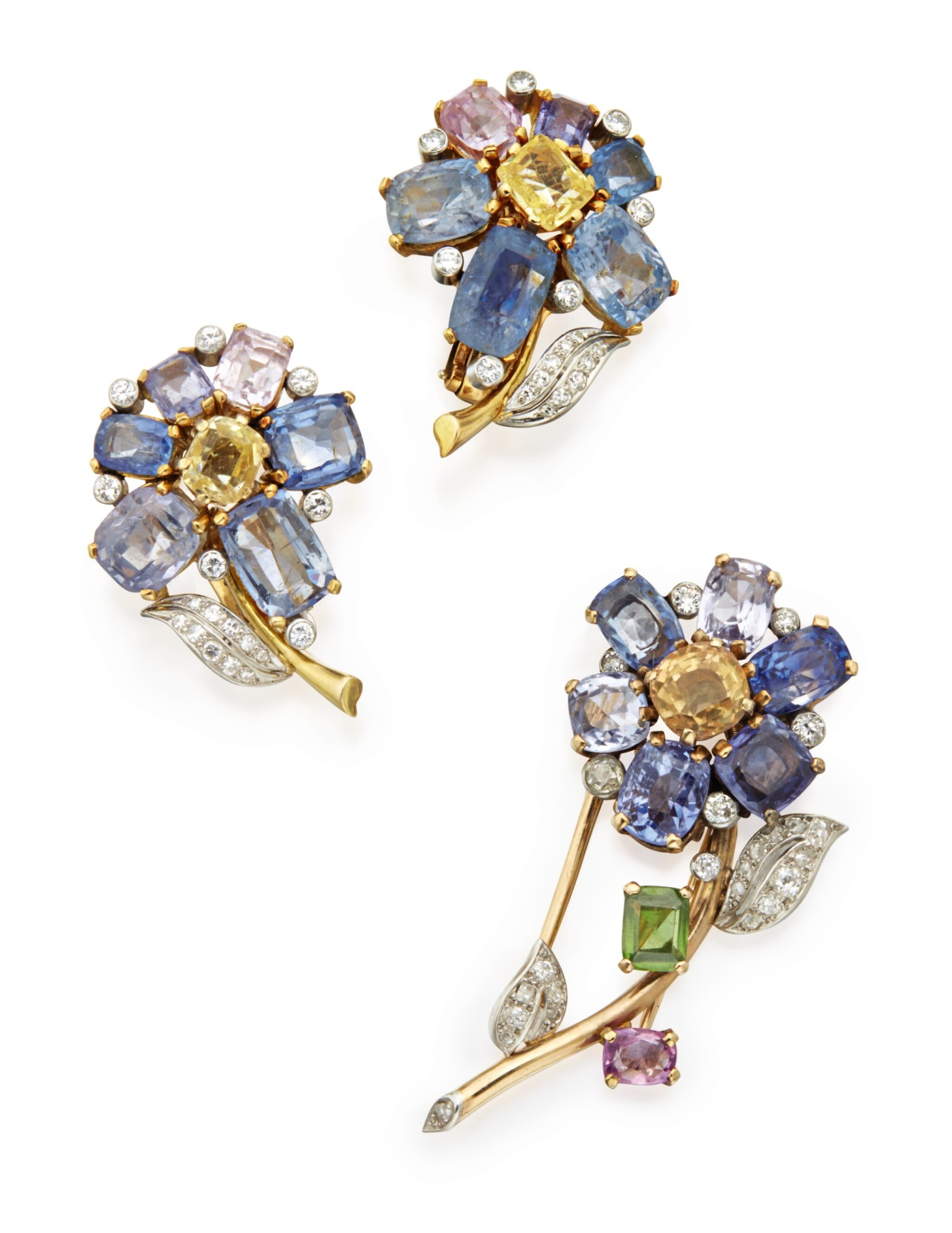 View full screen - View 1 of Lot 315. GOLD, GEM-SET, AND DIAMOND CLIP-BROOCH, CARTIER, LONDON AND PAIR OF EARCLIPS.