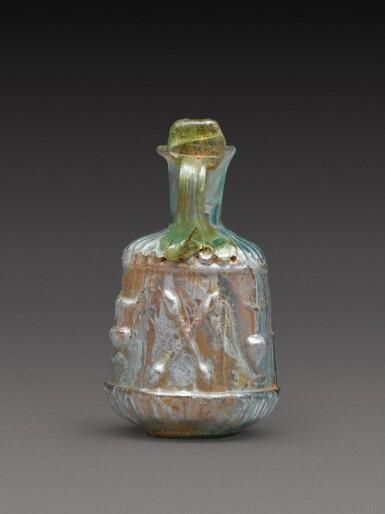 View 4. Thumbnail of Lot 4. A Roman Pale Green Mould-Blown Glass Flask, circa 1st century A.D..
