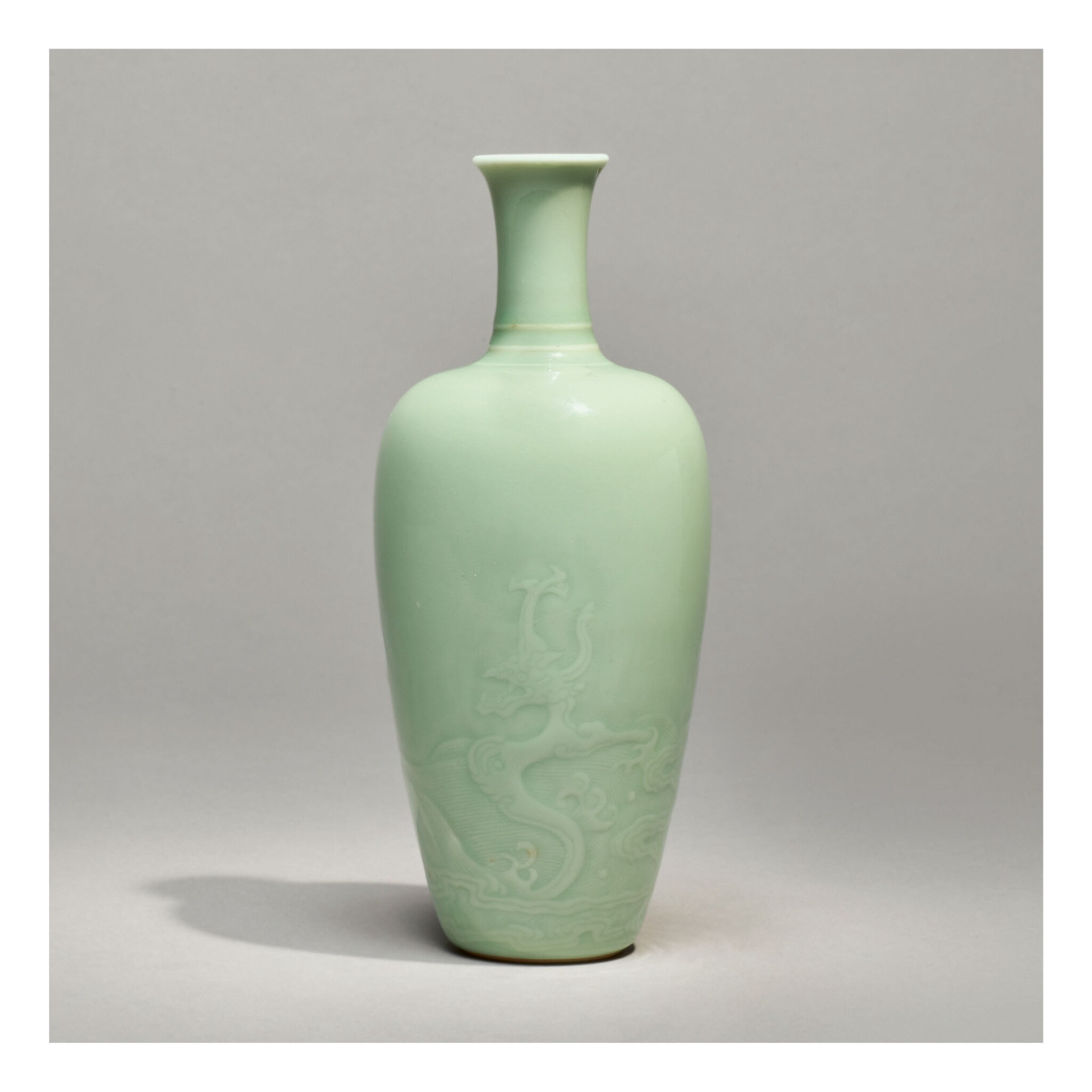 View full screen - View 1 of Lot 117.  A RARE CELADON-GLAZED 'DRAGON' AMPHORA VASE,  KANGXI MARK AND PERIOD.