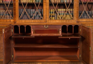 View 2. Thumbnail of Lot 59. A Regency brass inlaid and ebony strung mahogany breakfront library bookcase, circa 1815.