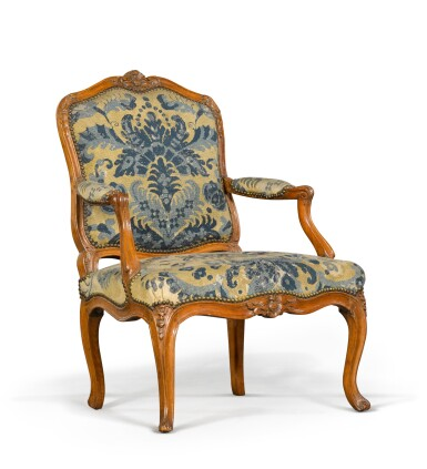 View 2. Thumbnail of Lot 79. A pair of Louis XV carved beechwood fauteuils à la reine, one mid-18th century, the other a later copy.