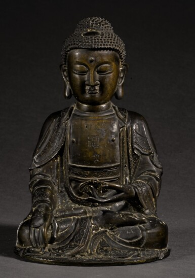 View 1. Thumbnail of Lot 349. A BRONZE SEATED FIGURE OF SHAKYAMUNI MING DYNASTY, 16TH/17TH CENTURY | 明十六/十七世紀 銅釋迦穆尼坐像.