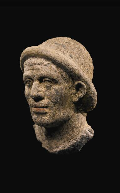 View 2. Thumbnail of Lot 37. AN ETRUSCAN NENFRO PORTRAIT HEAD OF A MAN, LATE 2ND/EARLY 1ST CENTURY B.C..