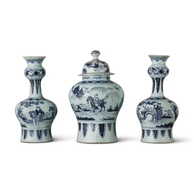 A PAIR OF DUTCH DELFT BLUE AND WHITE BOTTLE-SHAPED VASES AND A BALUSTER VASE AND COVER, CIRCA 1700 AND LATE 17TH CENTURY