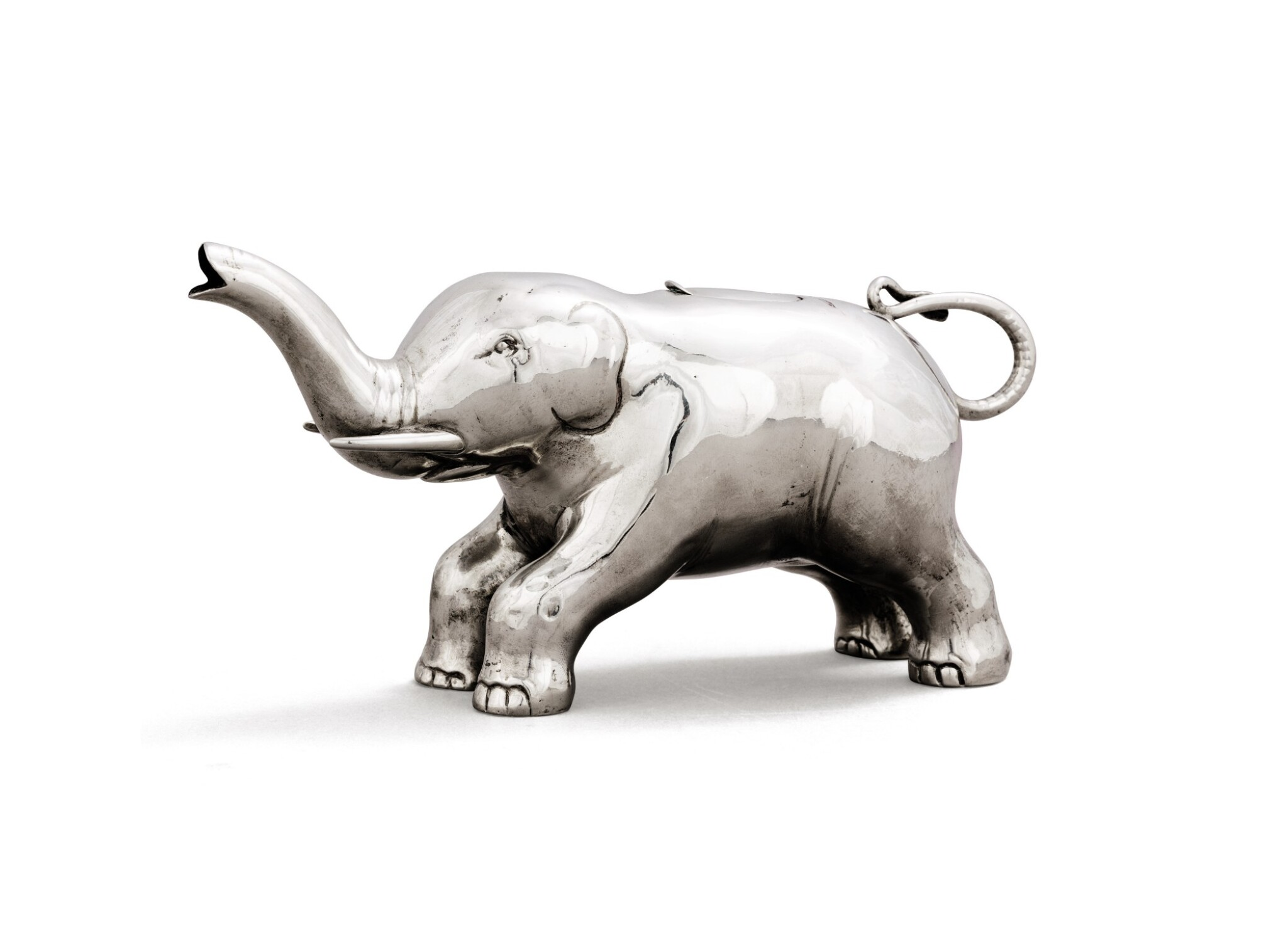 View full screen - View 1 of Lot 31. A German silver novelty cream jug in the form of an elephant, circa 1900,.